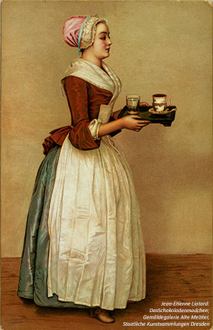 European woman with tray of hot chocolate.