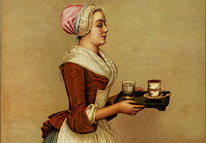 European woman carrying a tray with hot chocolate