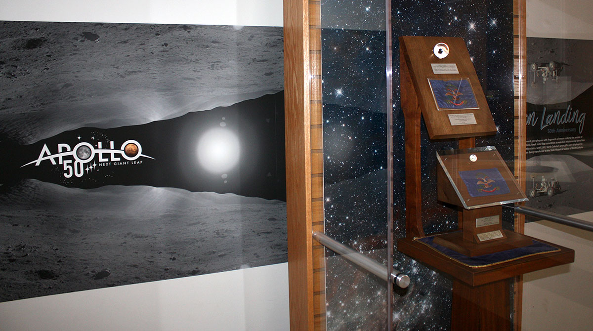 Moon Landing exhibit with moon rocks and wall graphic