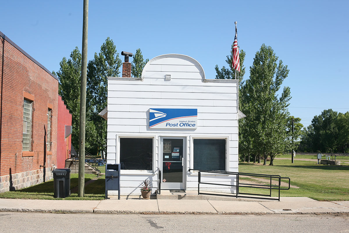 outside of post office with a mail box in front