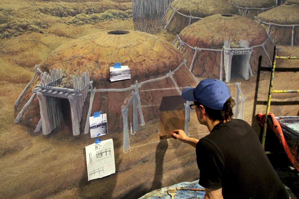 Artist Rob Evans painting the Double Ditch Indian Village cyclorama